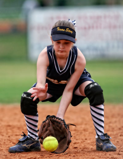 Canva Softball Player About to Catch the Ball
